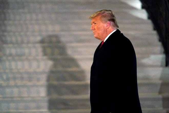 Then-President Donald Trump arrives on the South Lawn of the White House after returning from Texas on Jan. 12, 2021.
