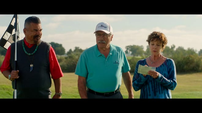 Herb (George Lopez) tends to the pin as Joe (Edward James Olmos) eyes a putt and wife Sheila (Kathleen Quinlan) keeps score.