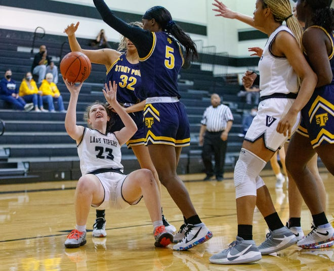 Vandegrift Vipers forward Skye O'Rourke, left, shoots the ball while falling to the court as Stony Point Tigers guard Nariyah Buggs defends during the first period at the District 25-6A girls basketball game on Feb. 8 at Vandegrift High School.