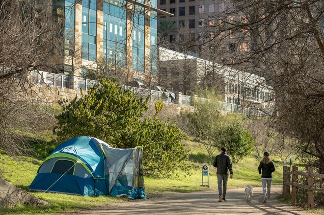 A homeless person's tent is set up on the Ann and Roy Butler Hike and Bike Trail not far from Austin City Hall earlier this month.