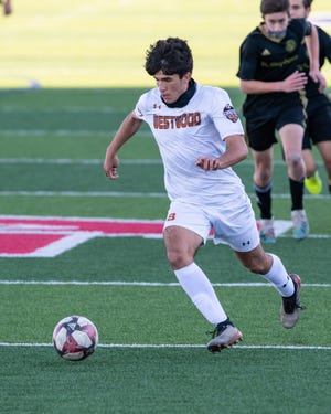Diego Djordjevic, bringing the ball upfield for Westwood in a match against St. Stephen's earlier this season, helped the Warriors go 3-0 in District 25-6A play last week.