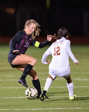 Round Rock senior Bella Courter, left, controls the ball as Cherlyn Quevedo defends for Hutto. Round Rock celebrated senior night at home with a 5-0 win over Hutto in a district girls soccer match Feb. 5.
