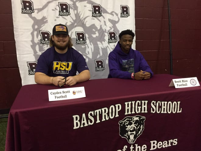 Bastrop football teammates Cayden Scott and Brett Rice signed with rival colleges in the same conference on national signing day on Feb. 3.