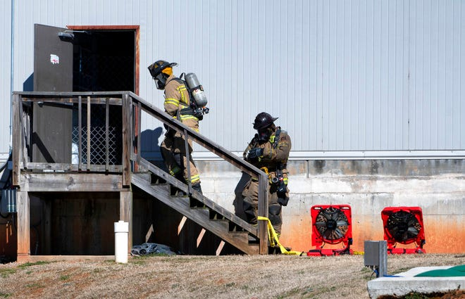 Two Hall County Firefighters enter a back door Friday, Jan. 29, 2021, at Foundation Food Group in Gainesville, Ga., the day after six people were killed following a liquid nitrogen leak at the plant. (Scott Rogers/The Times via AP)
