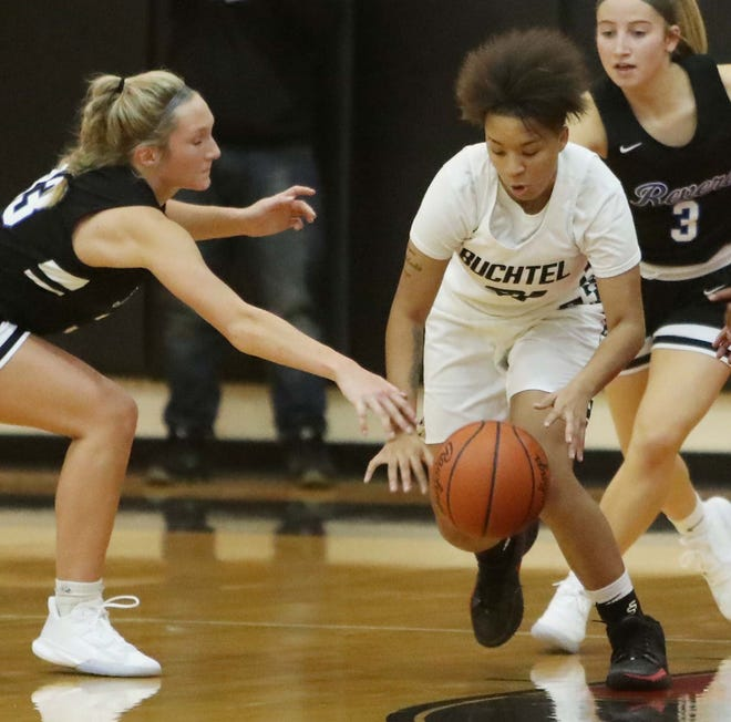 Buchtel's Amiyah Stallings, right,l gets to a loose ball in front of Revere's Ava Schiesswohl during the Griffins' 56-35 victory Monday night in Akron. [Karen Schiely/Beacon Journal]