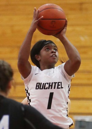 Buchtel's Da'Veonna Nash shoots the ball during the Griffins' 56-35 win over Revere on Monday night in Akron. [Karen Schiely/Beacon Journal]