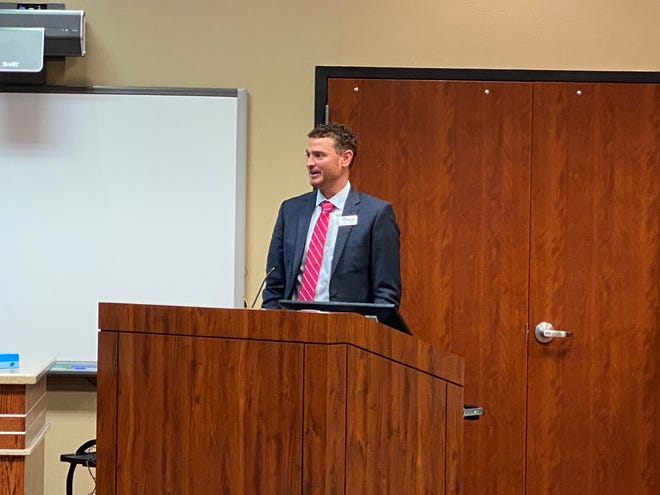 Eric Gomez, the current assistant principal at Canyon High School, speaks to the district's board of education after being named the first principal of West Plains High School.