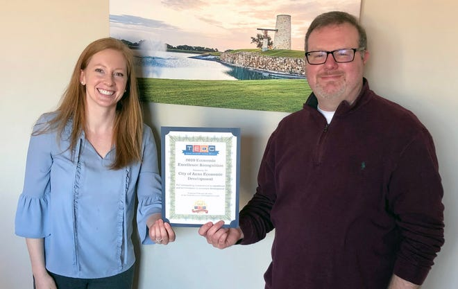 Anna EDC members Taylor Lough and Joey Grisham show the certificate recognizing their team for economic excellence Anna Economic Development Team Recognized.