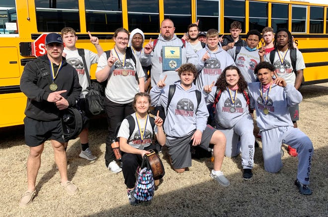 The Ardmore High School powerlifting team poses for a photo after winning a title as a large school at the Bethel powerlifting meet. Pictured in front row, from left; Avi Hill, Kolby Lamb, Matthew Sheehy and Ricky Smith. Back row from left; Birch Wood, Riley Cox, Elle Fairmainer, Trayven Newberry, coach Allen Coley, Parker Blankenship, Trae Coley, Ethan Moen, JaQuan Pickens, Jackson Arthur and Joseph Martin.