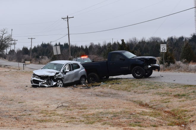Two crashed vehicles sit on an icy Prairie Valley Road Tuesday, Feb. 9, 2021, with an Oklahoma Highway Patrol vehicle immediately behind. Icy roads led to multiple crashes across southern Oklahoma.