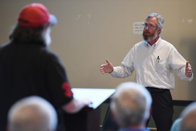Augusta Engineering Manager Wes Byne (right) answers a resident's question at a 2015 community meeting about the city imposing a new stormwater utility fee on residents. The Augusta Commission on Tuesday approved hiring Byne as director of Augusta Utilities.  [FILE/STAFF]