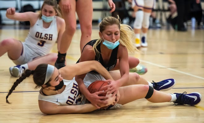 OLSH's Kennedy Walsh battles with South Side's Emily Bailey for a loose ball during their game Monday at OLSH in Coraopolis.
