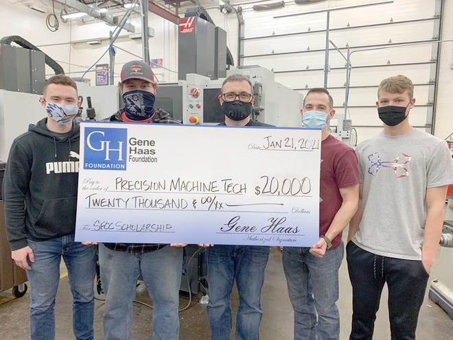 The Gene Haas Foundation recently donated $20,000 to SFCC's Precision Machining Technology program and awarded scholarships to three SFCC students. From left, SFCC students Shae Childers, and Laben Twenter, SFCC Precision Machining Technology Program Coordinator Justin Wright, SFCC students John Kinkaid and Bret Hockett.