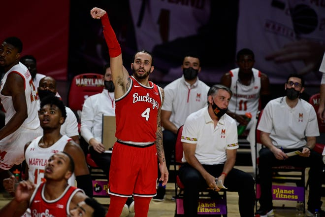 Feb 8, 2021; College Park, Maryland, USA;  Ohio State Buckeyes guard Duane Washington Jr. (4) looks on after shooting a three point shot during the first half against the Maryland Terrapins at Xfinity Center. Mandatory Credit: Tommy Gilligan-USA TODAY Sports