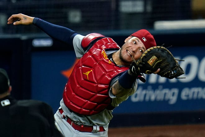 St. Louis Cardinals catcher Yadier Molina catches a foul ball during a playoff game against the San Diego Padres last October in San Diego.