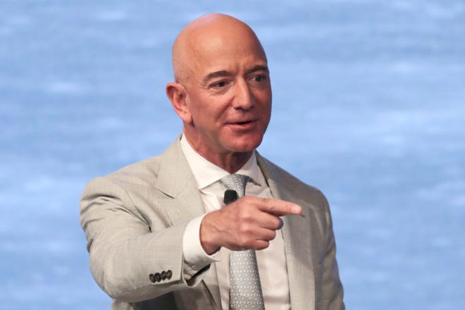 FILE - In this June 19, 2019, file photo, Amazon founder Jeff Bezos speaks during the JFK Space Summit at the John F. Kennedy Presidential Library in Boston. Bezos is one of the 50 Americans who gave the most to charity in 2020, according to the Chronicle of Philanthropy's annual rankings. (AP Photo/Charles Krupa, File)