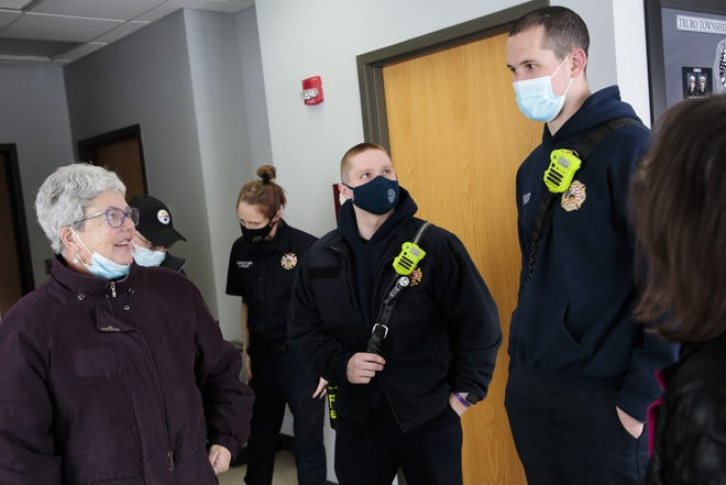 Emily Troiano, left, founder of the Columbus chapter of Cookies for Caregivers, chats with firefighters Tyler Gleeson, right, and Parker Ketler, center, following a Tuesday delivery at the Truro Township Fire Department in Reynoldsburg.