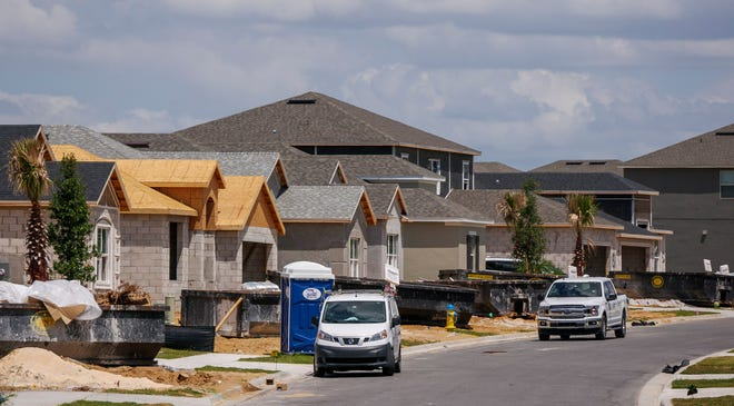 Homes are under construction at Esplanade at Highland Ranch in Clermont in 2020.