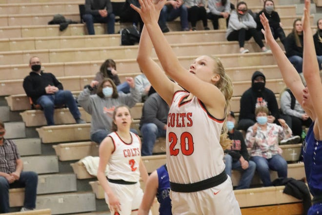 Meadowbrook's Kaylynn Gombeda goes up for two points against Harrison Central during Monday's home game in Byesville.