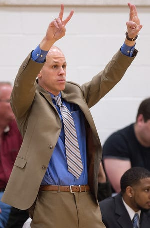 DDCC coach Matt Ridge calls a play for his team during the game against Johnston Community College. The Storm beat Patrick Henry Community College on Monday. [Donnie Roberts/The Dispatch]