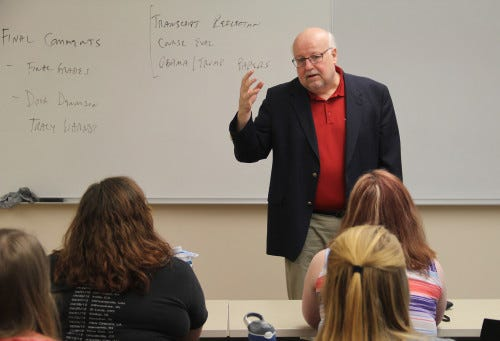 """Monmouth College political science lecturer Robin Johnson talks with his """"Politics and Government in the Midwest"""" students in this file photo. Johnson has organized a Zoom session on Feb. 15 featuring five young alumni who were involved in politics over the course of the past year."""