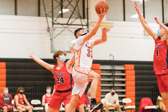 Wellsville's Brayden Delahunt flies in for the layup on Monday evening in Wellsville for a contest against rival Hornell.