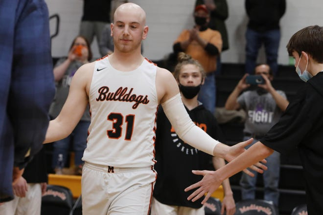 """Mediapolis High School senior  Regan Thornburg (31) is introduced before the start of their game against Louisa-Muscatine High School, Monday Feb. 8, 2021at Mediapolis Vernon """"Bud"""" McLearn Court. Thornburg returned to the court for Senior Night while battling Hodgkins Lymphoma."""