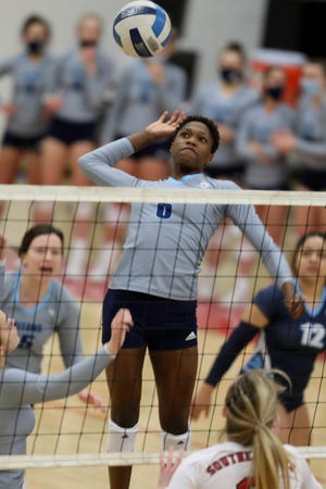 Iowa Central Community College's Angel Baylark (6) goes up to spike the ball during their game against Southeastern Community College, Sunday Feb. 7, 2021 at SCC's Loren Walker Arena.