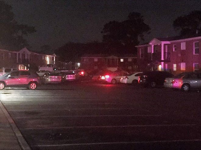 Police investigate Monday night's triple fatal shooting at the Calloway Cove Apartments on Moncrief Road.