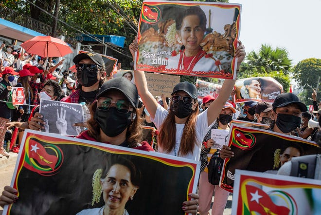 Protesters hold placards with portraits of Aung San Suu Kyi during the demonstration on Feb. 9, 2021 in Yangon, Myanmar. Thousands of people took to the streets of Yangon on the fourth day of protest against the military coup and demanded the release of Aung San Suu Kyi. Myanmar's military detained State Counsellor of Myanmar Aung San Suu Kyi on Feb. 1, 2021, and declared a state of emergency while seizing the power in the country for a year after losing the election against the National League for Democracy.