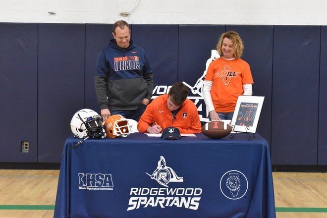 AlWood senior Lucas Althaus, who plays for Ridgewood, signs a letter of intent on Wednesday, Feb. 3, to play football at the University of Illinois. Althaus plans to major in ag business.