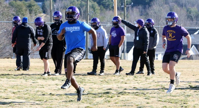 North Henderson's football players participate in the first official practice of the season on Monday at North.