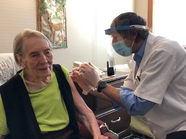 Margaret Ikerd, a 102-year-old resident of Kidron Bethel Village, receives her first dose of the COVID-19 vaccine. Ikerd has seen a number of historic events in her lifetime.