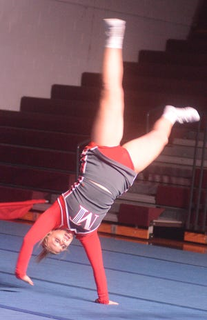 Doing a cartwheel for the McPherson College Bulldogs at the Bethel Invitational.