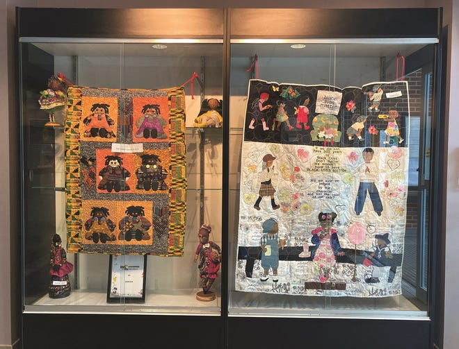 This display at the Twinsburg Public Library highlights the work of  Doressa Carlton of Doressa's Dolls.
