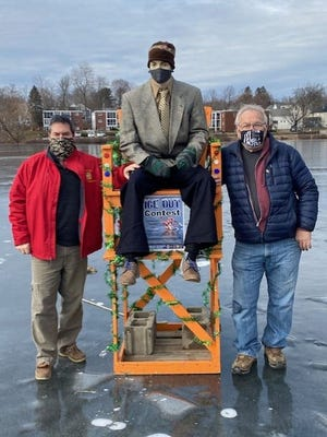 """""""Rocky"""" the mannequin returned to the ice at Rockwell Pond on Jan. 26 to raise money for five local veterans' groups. Pictured with the man of the hour are Richard Voutour, left, veterans' service officer for Leominster, Lancaster and Sterling, and fundraiser organizer Ralph Sacramone, right."""
