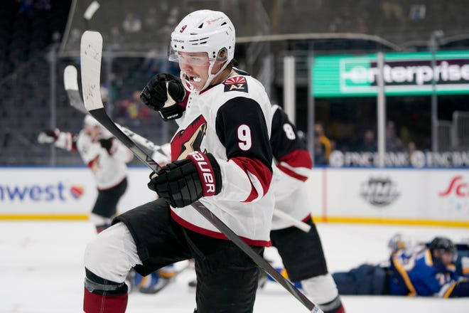 Arizona Coyotes' Clayton Keller (9) celebrates after scoring with less than a second left during the third period of to tie an NHL hockey game against the St. Louis Blues Monday, Feb. 8, 2021, in St. Louis. The Coyotes won in a shootout.