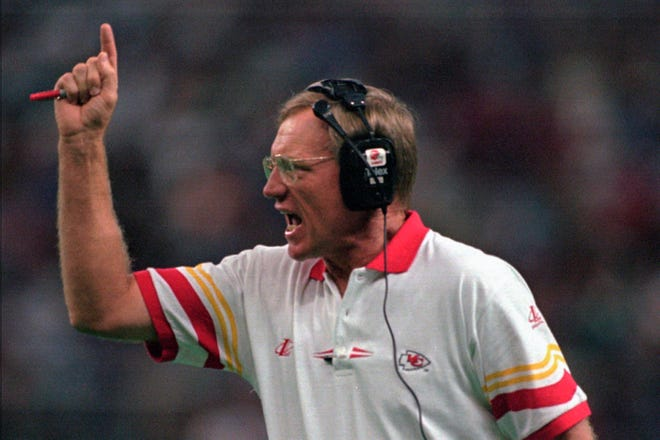 FILE - In this Sept. 15, 1996, file photo, Kansas City Chiefs coach Marty Schottenheimer yells instructions to his team as they play against the Seattle Seahawks in Seattle.