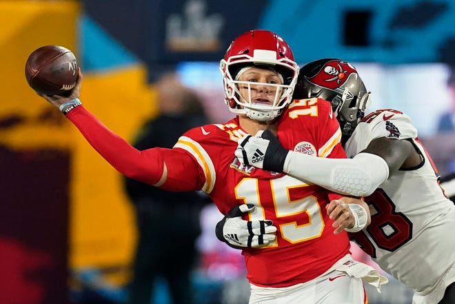 Kansas City Chiefs quarterback Patrick Mahomes passes under pressure from Tampa Bay Buccaneers outside linebacker Shaquil Barrett during the first half of the NFL Super Bowl 55 football game Sunday, Feb. 7, 2021, in Tampa, Fla.