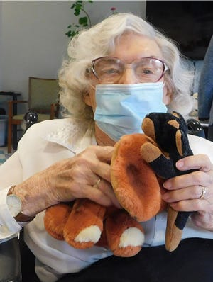 """Westwood Commons resident Mary Rohrbacher shows off the """"pets"""" she """"adopted"""" from a donation of stuffed animals from the Residents of Chili Facebook group."""