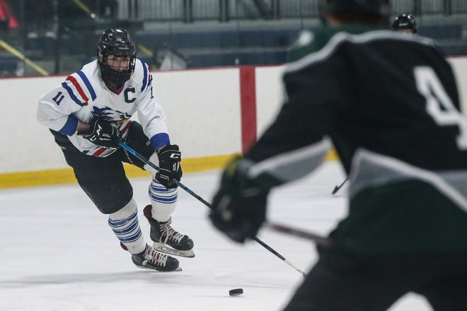 Hopedale/Millis senior Hunter Dunn (Douglas) takes the puck up the ice during a boys hockey game against Grafton/Blackstone Valley Tech at Blackstone Valley IcePlex in Hopedale on Feb. 08, 2021. Dunn scored two goals in a win for Hopedale/Millis on Saturday.