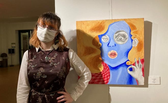 Aurora Reynolds stands next to her untitled mixed media piece. (Courtesy photo)