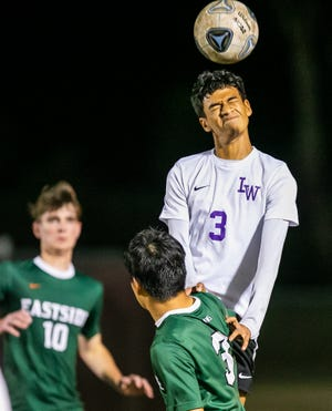 Lake Weir's Alejandro Torres heads the ball in the second half. The Hurricanes fell to the Eastside Rams in the District 4A-9 Final on Monday.