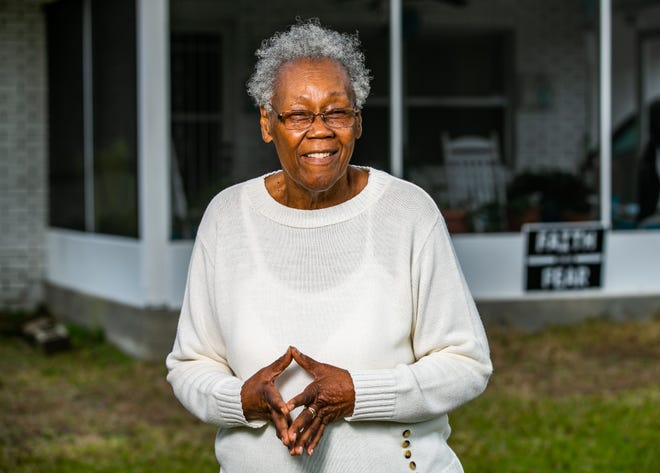 Irene Donar stands outside her Santos home last week. Donar grew up in Santos and remembers when it was a thriving African American community. She lives just about two miles from where she grew up.