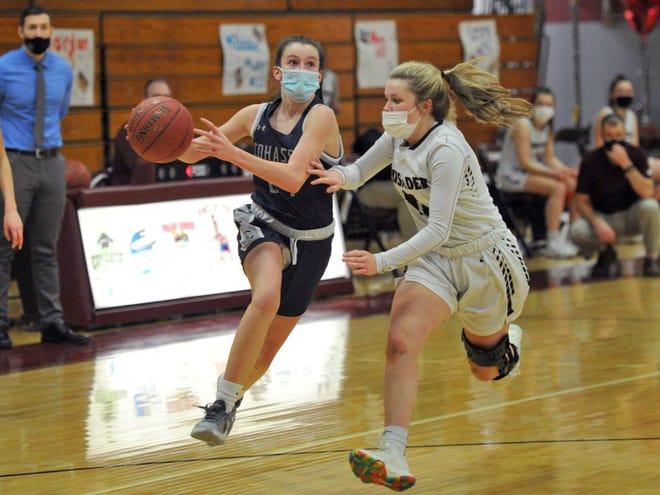 Cohasset's Sarah Chenette drives against Carver's Ashleigh Johnson during girls basketball at Carver High School, Monday, Feb. 8, 2021.