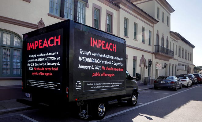 "As former President Donald Trump's impeachment trial got under way on Feb. 9, a truck bearing a digital sign that reads ""IMPEACH"" was parked outside of Town Hall. Trump was acquitted."