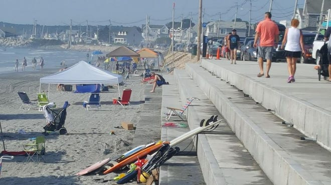 There's a tiered seawall, pictured here in this file photo, near the Long Sands Bathhouse in York, Maine. The town has been expecting FEMA to reimbursement for costs to build the seawall, but the town is still waiting.