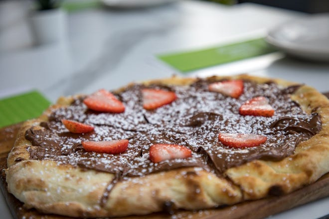 On the dessert menu at Vivo Pizza and Pasta: Nutella pizzetta topped with strawberries. VIVO