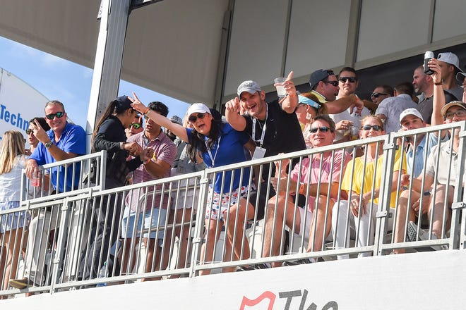 Fans pose for a picture at the 17th hole during the final round of the Honda Classic last March.