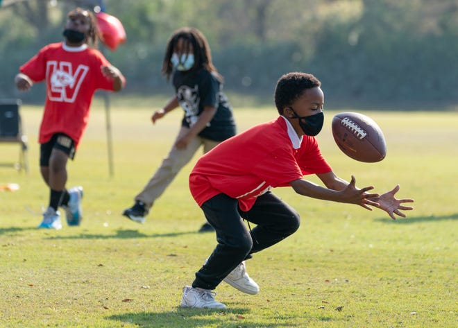 Children play football earlier this month at a Super Bowl party for the students from the Edna W. Runner Tutorial Center in Jupiter. The center, on Church Street near Jupiter Community Park, offers a variety of after-school programs for at-risk children in the Jupiter area.